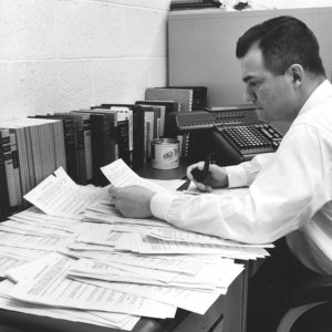 A business education student from Wisconsin studies at a desk