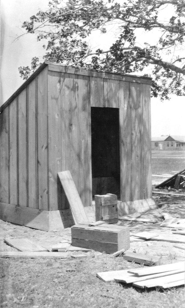 Photograph of a sanitary privy meeting public health standards that is under construction.