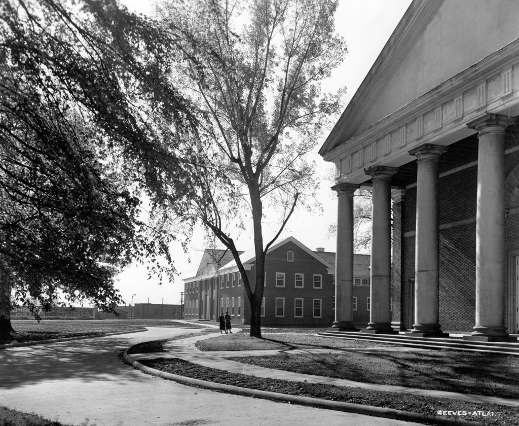 View of two buildings with columns in front of a green, at Spelman College, a historically black college.