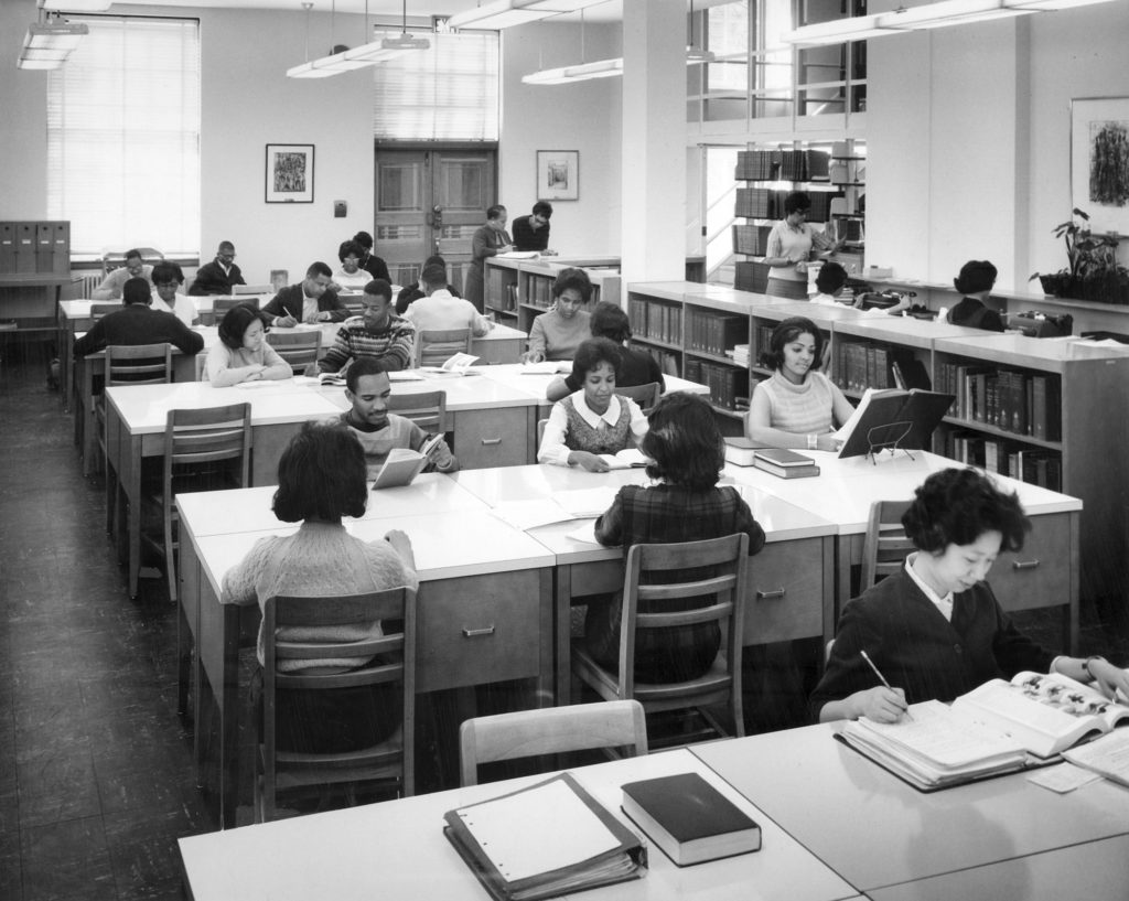 African American students sit at tables and study at the Atlanta University library around 1960.