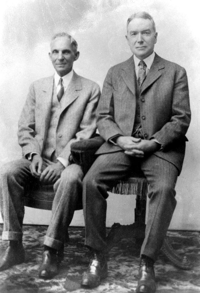 Portrait of Henry Ford and John D. Rockefeller, Jr., seated.